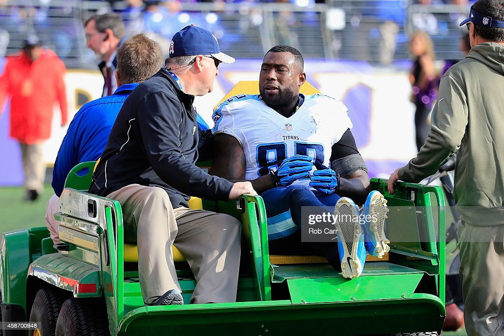 Tight end Delanie Walker of the Tennessee Titans is carted off the field after taking a hit from free safety Terrence Brooks of the Baltimore Ravens...