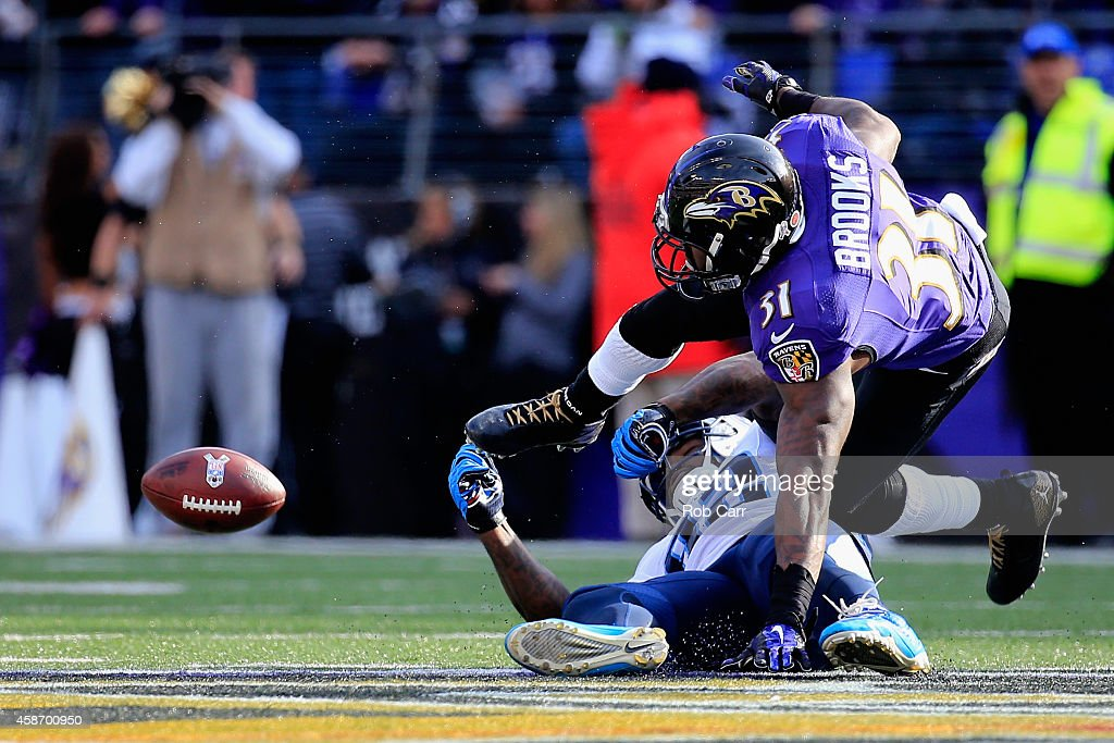 Tight end Delanie Walker of the Tennessee Titans takes a second quarter hit from free safety Terrence Brooks of the Baltimore Ravens at MT Bank...