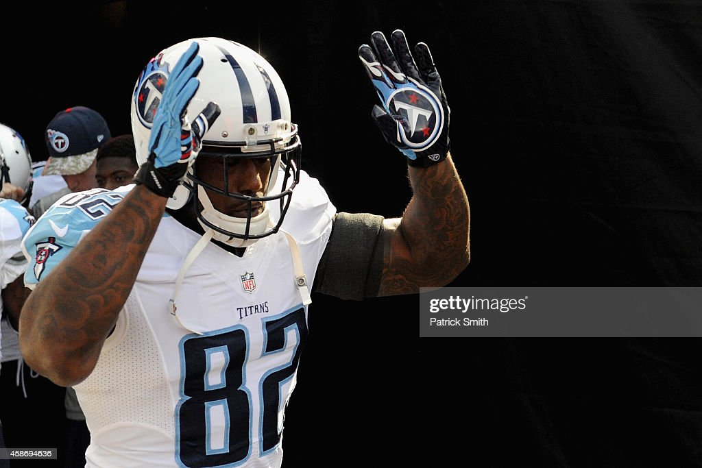 Tight end Delanie Walker of the Tennessee Titans takes the field to warm up before a game against the Baltimore Ravens at MT Bank Stadium on November...