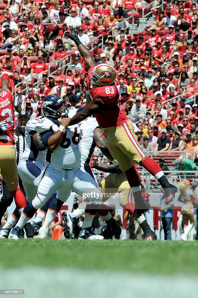 Tight end <a gi-track='captionPersonalityLinkClicked' href=/galleries/search?phrase=Demarcus+Dobbs&family=editorial&specificpeople=4780529 ng-click='$event.stopPropagation()'>Demarcus Dobbs</a> #83 of the San Francisco 49ers jumps to block a pass against the Denver Broncos during a preseason game at Levi's Stadium on August 17, 2014 in Santa Clara, California.