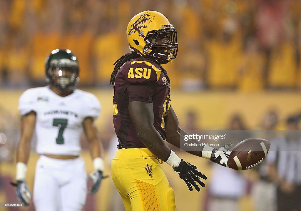 Tight end De'Marieya Nelson #12 of the Arizona State Sun Devils flips the football after scoring a 15 touchdown reception against the Sacramento State Hornets during the first quarter of the college football game at Sun Devil Stadium on September 5, 2013 in Tempe, Arizona.