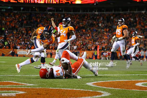 Tight end Demetrius Harris of the Kansas City Chiefs catches a pass for a two point conversion in the fourth quarter at Sports Authority Field at...