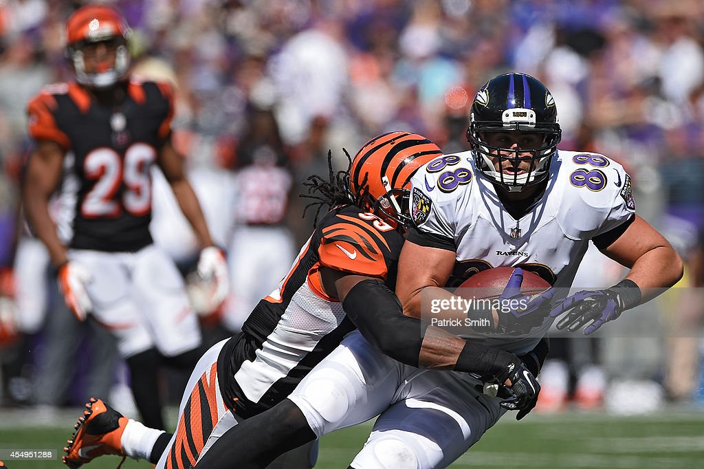 Tight end <a gi-track='captionPersonalityLinkClicked' href=/galleries/search?phrase=Dennis+Pitta&family=editorial&specificpeople=5516841 ng-click='$event.stopPropagation()'>Dennis Pitta</a> #88 of the Baltimore Ravens is tackled by linebacker <a gi-track='captionPersonalityLinkClicked' href=/galleries/search?phrase=Emmanuel+Lamur&family=editorial&specificpeople=6335983 ng-click='$event.stopPropagation()'>Emmanuel Lamur</a> #59 of the Cincinnati Bengals in the second half at M&T Bank Stadium on September 7, 2014 in Baltimore, Maryland. The Cincinnati Bengals won, 23-16.