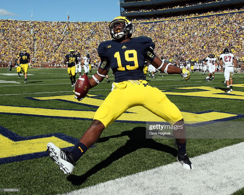 Tight End Devin Funchess of the University of Michigan Wolverines scores a touchdown in the first quarter during a Big Ten College football game...