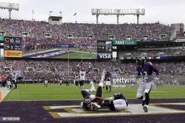 Tight End Dion Sims of the Chicago Bears scores a touchdown in the third quarter against the Baltimore Ravens at MT Bank Stadium on October 15 2017...