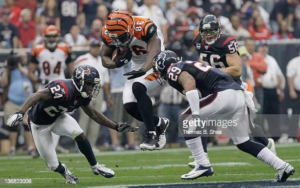Tight end Donald Lee of the Cincinnati Bengals splits cornerback Johnathan Joseph of the Houston Texans and strong safety Glover Quin of the Houston...
