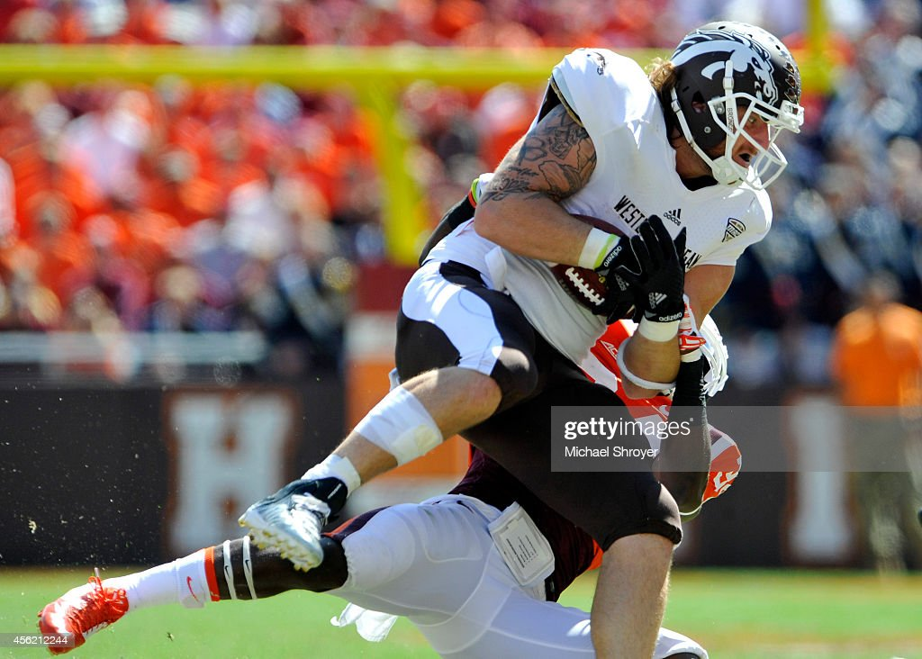 Tight end Eric Boyden #89 of the Western Michigan Broncos is tackled after a reception against the Virginia Tech Hokies in the second half at Lane Stadium on September 27, 2014 in Blacksburg, Virginia. Virginia Tech defeated Western Michigan 35-17.