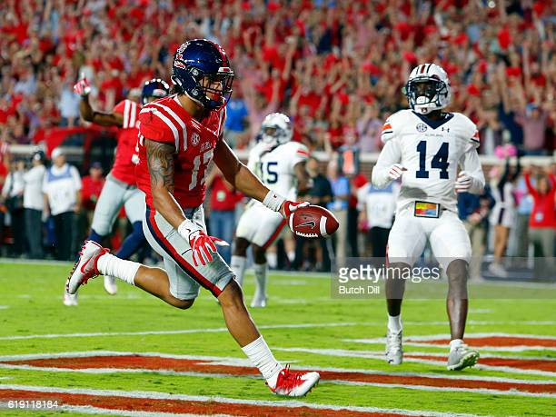 Tight end Evan Engram of the Mississippi Rebels catches a pass for a touchdown against the Auburn Tigers during the first half of an NCAA college...