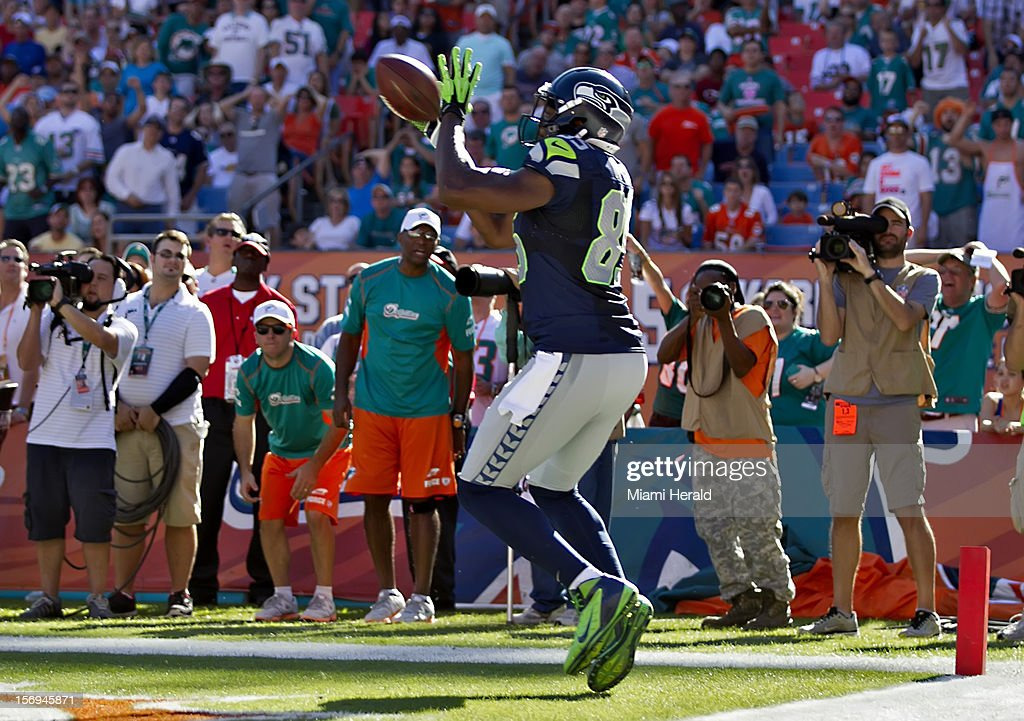 Tight end Evan Moore catches a touchdown pass in the second quarter as the Miami Dolphins beat the Seattle Seahawks 24-21 at Sun Life Stadium in Miami Gardens, Florida, November 25, 2012.