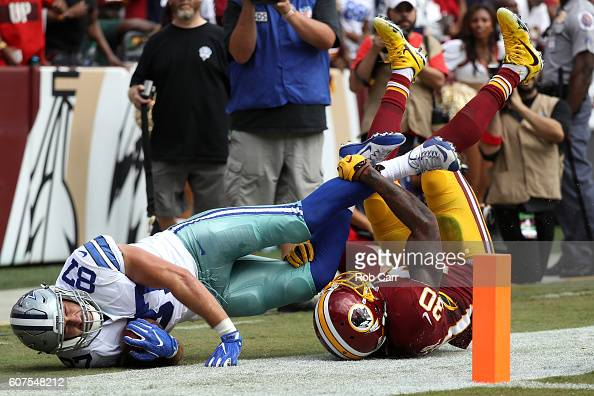 Tight end Geoff Swaim of the Dallas Cowboys is tackled by strong safety David Bruton of the Washington Redskins in the first quarter at FedExField on...