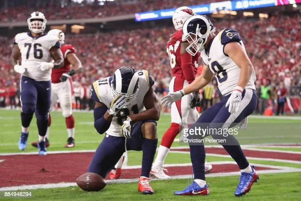 Tight end Gerald Everett of the Los Angeles Rams reacts after scoring a first quarter touchdown during the NFL game against the Arizona Cardinals at...