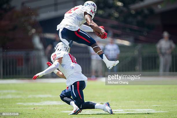 Tight end Gerald Everett of the South Alabama Jaguars leaps over tight end Grant Powell of the South Alabama Jaguars during their game against the...