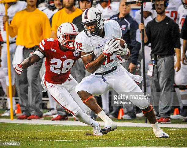 Tight end Gerald Everett of the South Alabama Jaguars tries to elude defensive back Byerson Cockrell of the Nebraska Cornhuskers during their game at...