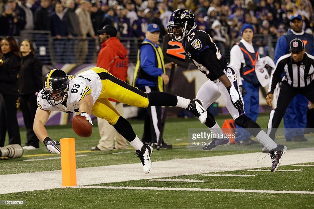Tight end <a gi-track='captionPersonalityLinkClicked' href=/galleries/search?phrase=Heath+Miller&family=editorial&specificpeople=748767 ng-click='$event.stopPropagation()'>Heath Miller</a> #83 of the Pittsburgh Steelers scores a touchdown after catching a pass in front of cornerback <a gi-track='captionPersonalityLinkClicked' href=/galleries/search?phrase=Corey+Graham&family=editorial&specificpeople=4294650 ng-click='$event.stopPropagation()'>Corey Graham</a> #24 of the Baltimore Ravens during the fourth quarter of the Steelers 23-20 win at M&T Bank Stadium on December 2, 2012 in Baltimore, Maryland.