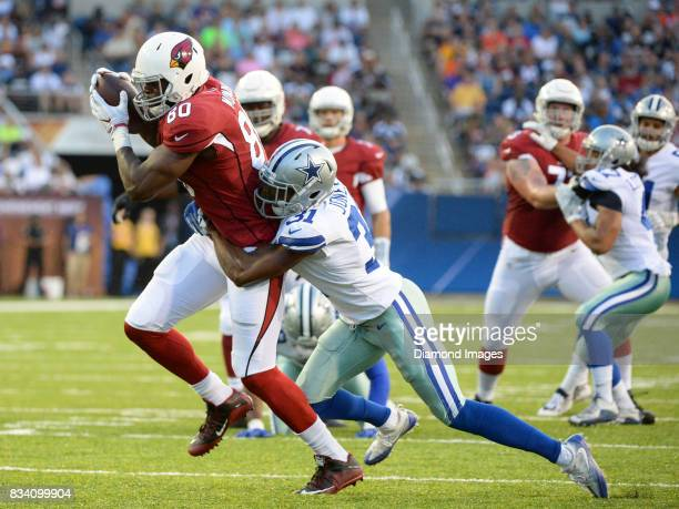 Tight end Ifeanyi Momah of the Arizona Cardinals catches a pass as he is tackled by cornerback Byron Jones of the Dallas Cowboys in the first quarter...