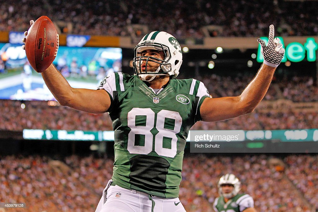 Tight end <a gi-track='captionPersonalityLinkClicked' href=/galleries/search?phrase=Jace+Amaro&family=editorial&specificpeople=10097057 ng-click='$event.stopPropagation()'>Jace Amaro</a> #88 of the New York Jets celebrates a touchdown reception in the second quarter of a preseason game against the New York Giants at MetLife Stadium on August 22, 2014 in East Rutherford, New Jersey.