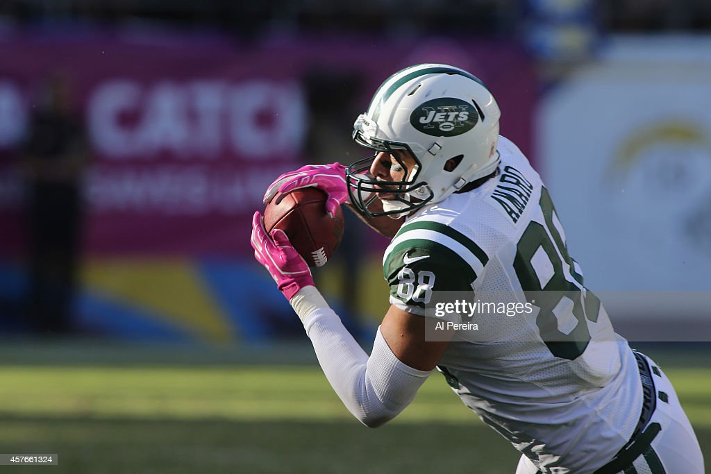 Tight End <a gi-track='captionPersonalityLinkClicked' href=/galleries/search?phrase=Jace+Amaro&family=editorial&specificpeople=10097057 ng-click='$event.stopPropagation()'>Jace Amaro</a> #88 of the New York Jets makes a catch against the San Diego Chargers at Qualcomm Stadium on October 5, 2014 in San Diego, California.