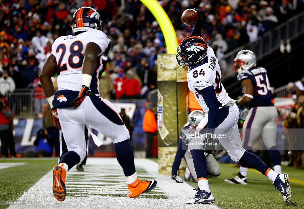 Tight end Jacob Tamme #84 of the Denver Broncos celebrates a touchdown with running back Montee Ball #28 against the New England Patriots during a game at Gillette Stadium on November 24, 2013 in Foxboro, Massachusetts.