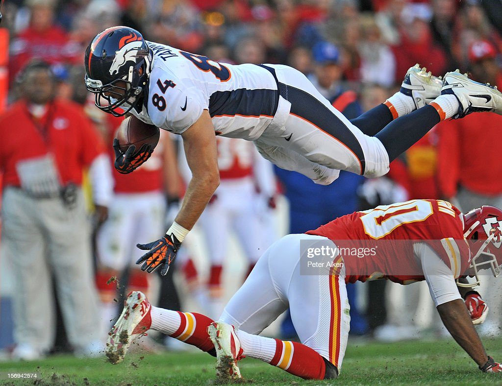 Tight end Jacob Tamme #84 of the Denver Broncos goes airborne after getting upended by defensive back Jalil Brown #30 of the Kansas City Chiefs during the second half on November 25, 2012 at Arrowhead Stadium in Kansas City, Missouri. Denver defeated Kansas City 17-9.