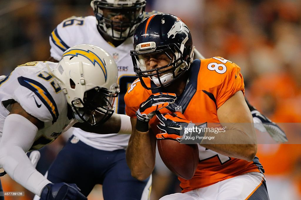 Tight end <a gi-track='captionPersonalityLinkClicked' href=/galleries/search?phrase=Jacob+Tamme&family=editorial&specificpeople=2128594 ng-click='$event.stopPropagation()'>Jacob Tamme</a> #84 of the Denver Broncos prepares to get hit by inside linebacker <a gi-track='captionPersonalityLinkClicked' href=/galleries/search?phrase=Kavell+Conner&family=editorial&specificpeople=4511295 ng-click='$event.stopPropagation()'>Kavell Conner</a> #53 of the San Diego Chargers after a reception during a game at Sports Authority Field at Mile High on October 23, 2014 in Denver, Colorado.