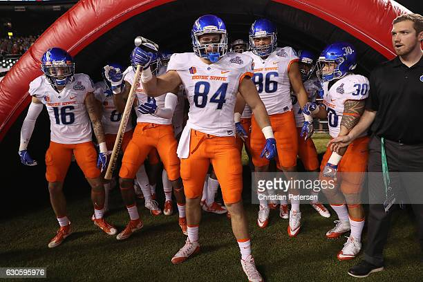 Tight end Jake Knight of the Boise State Broncos leads teamamtes onto the field before the start of the Motel 6 Cactus Bowl against the Baylor Bears...