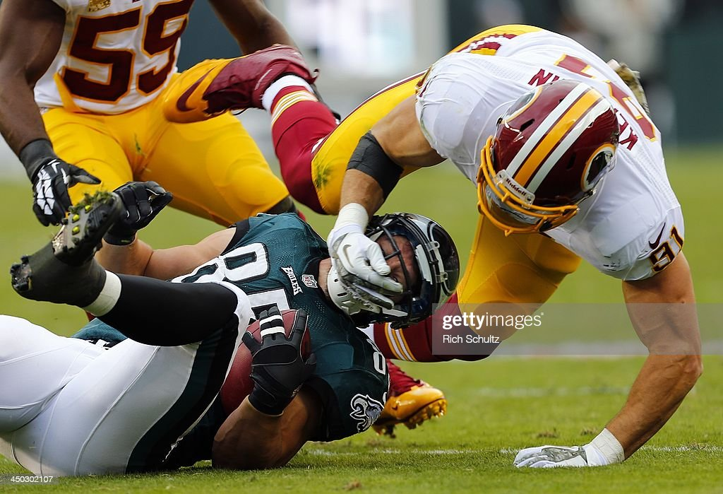 Tight end James Casey of the Philadelphia Eagles is tackled by Ryan Kerrigan the Washington Redskins during the first half of a game at Lincoln...