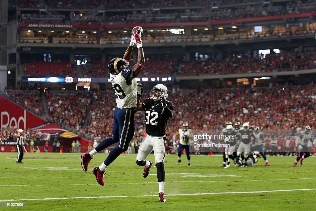 Tight end Jared Cook of the St Louis Rams can't haul in a pass while being defended by free safety Tyrann Mathieu of the Arizona Cardinals during the...