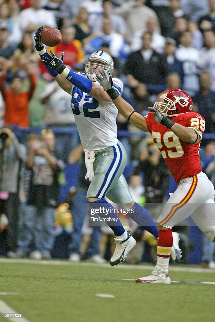 Tight End Jason Witten #82 of the Dallas Cowboys catches a touchdown pass over Safety Sammy Knight #29 of the Kansas City Chiefs on December 11, 2005 at Texas Stadium in Irving, Texas.