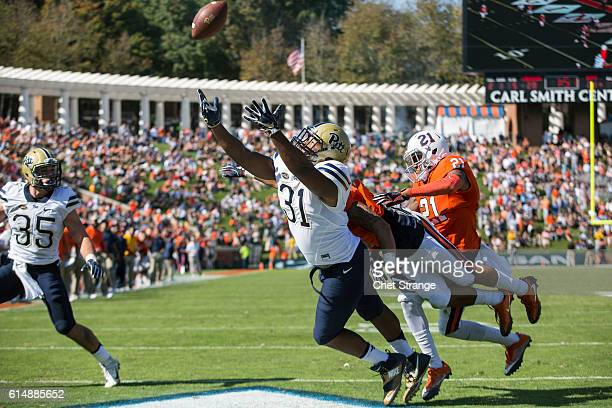Tight end Jaymar Parrish of the Pittsburgh Panthers stretches for the ball during the Panthers' game against the Virginia Cavaliers at Scott Stadium...