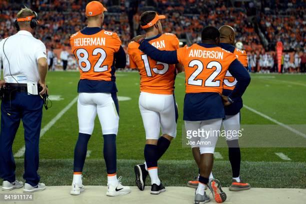 Tight end Jeff Heuerman quarterback Trevor Siemian running back CJ Anderson and cornerback Chris Harris of the Denver Broncos watch time running down...