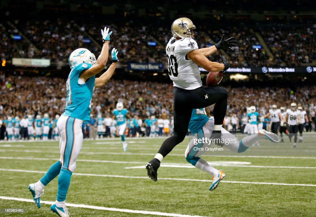 Tight end <a gi-track='captionPersonalityLinkClicked' href=/galleries/search?phrase=Jimmy+Graham&family=editorial&specificpeople=834247 ng-click='$event.stopPropagation()'>Jimmy Graham</a> #80 of the New Orleans Saints catches a 27-yard touchdown in the second quarter against the Miami Dolphins at the Mercedes-Benz Superdome on September 30, 2013 in New Orleans, Louisiana.