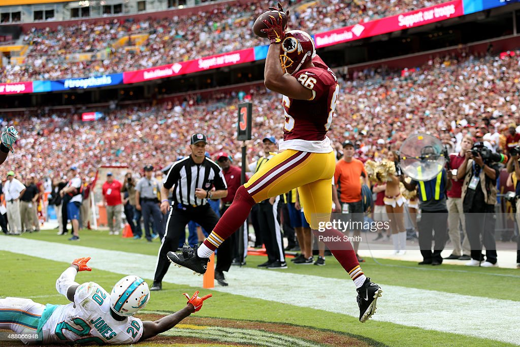 Tight end <a gi-track='captionPersonalityLinkClicked' href=/galleries/search?phrase=Jordan+Reed&family=editorial&specificpeople=6893664 ng-click='$event.stopPropagation()'>Jordan Reed</a> #86 of the Washington Redskins scores a first half touchdown past strong safety <a gi-track='captionPersonalityLinkClicked' href=/galleries/search?phrase=Reshad+Jones&family=editorial&specificpeople=4511449 ng-click='$event.stopPropagation()'>Reshad Jones</a> #20 of the Miami Dolphins during a game at FedExField on September 13, 2015 in Landover, Maryland.