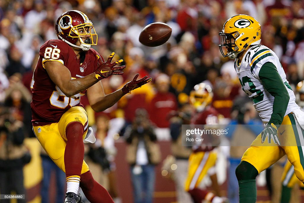 Tight end <a gi-track='captionPersonalityLinkClicked' href=/galleries/search?phrase=Jordan+Reed&family=editorial&specificpeople=6893664 ng-click='$event.stopPropagation()'>Jordan Reed</a> #86 of the Washington Redskins scores a second quarter touchdown past strong safety <a gi-track='captionPersonalityLinkClicked' href=/galleries/search?phrase=Micah+Hyde+-+American+Football+Player&family=editorial&specificpeople=11470001 ng-click='$event.stopPropagation()'>Micah Hyde</a> #33 of the Green Bay Packers during the NFC Wild Card Playoff game at FedExField on January 10, 2016 in Landover, Maryland.