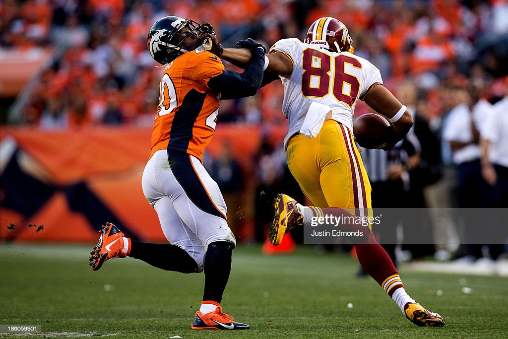 Tight end <a gi-track='captionPersonalityLinkClicked' href=/galleries/search?phrase=Jordan+Reed&family=editorial&specificpeople=6893664 ng-click='$event.stopPropagation()'>Jordan Reed</a> #86 of the Washington Redskins stiff-arms safety Mike Adams #20 of the Denver Broncos after making a reception during the fourth quarter at Sports Authority Field Field at Mile High on October 27, 2013 in Denver, Colorado. The Broncos defeated the Redskins 45-21.