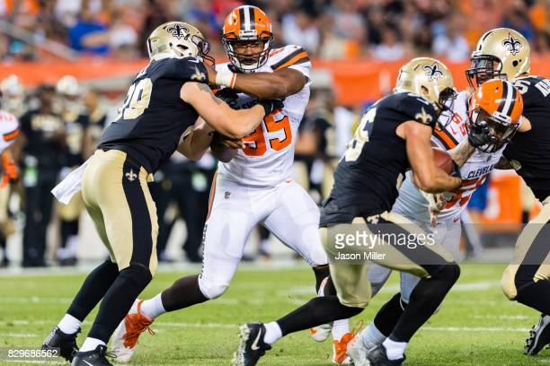 Tight end Josh Hill of the New Orleans Saints blocks defensive end Myles Garrett of the Cleveland Browns during the first half of a preseason game at...