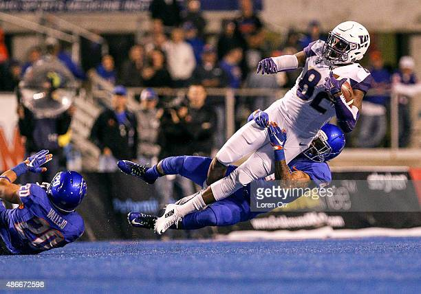 Tight end Joshua Perkins of the Washington Huskies is tackled by safety Darian Thompson of the Boise State Broncos on September 4 2015 at Albertsons...