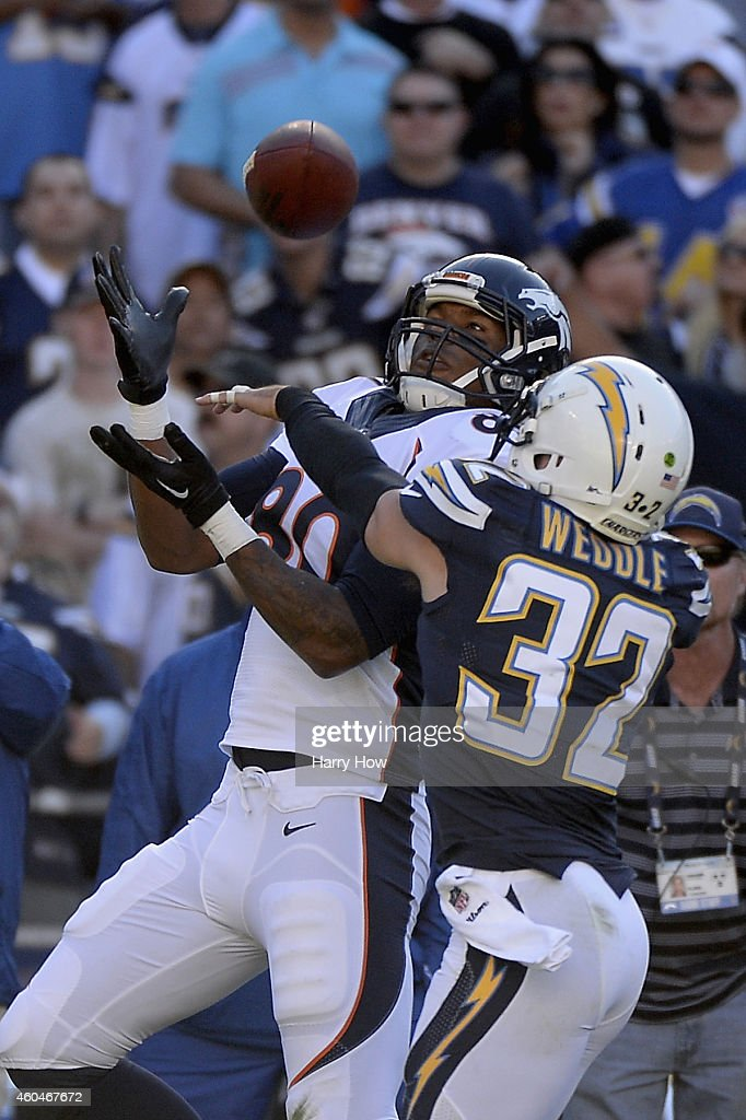 Tight end <a gi-track='captionPersonalityLinkClicked' href=/galleries/search?phrase=Julius+Thomas+-+American+Football+Player&family=editorial&specificpeople=11333769 ng-click='$event.stopPropagation()'>Julius Thomas</a> #80 of the Denver Broncos makes a 30-yard pass reception over free safety <a gi-track='captionPersonalityLinkClicked' href=/galleries/search?phrase=Eric+Weddle&family=editorial&specificpeople=2630547 ng-click='$event.stopPropagation()'>Eric Weddle</a> #32 of the San Diego Chargers at Qualcomm Stadium on December 14, 2014 in San Diego, California.