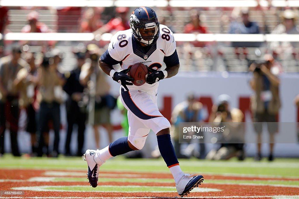 Tight end Julius Thomas #80 of the Denver Broncos scores against the San Francisco 49ers during a preseason game at Levi's Stadium on August 17, 2014 in Santa Clara, California.