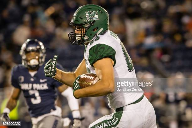 Tight end Kade Greeley of the Hawaii Rainbow Warriors runs to complete a touchdown during the second quarter against the Nevada Wolf Pack at Mackay...