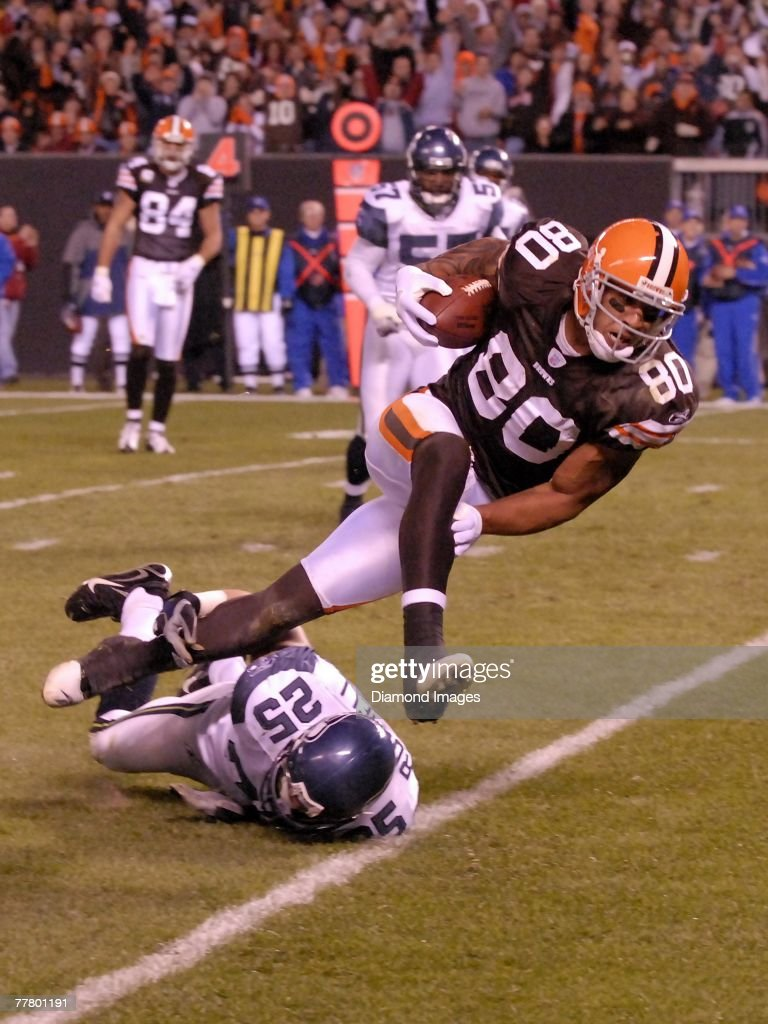 Tight end Kellen Winslow Jr. #80 of the Cleveland Browns hurdles defensive back Brian Russell #25 of the Seattle Seahawks after catching a pass during a game on November 4, 2007 at Cleveland Browns Stadium in Cleveland, Ohio. Cleveland won 33-30 in overtime. Kellen Winslow Jr.07-1224058