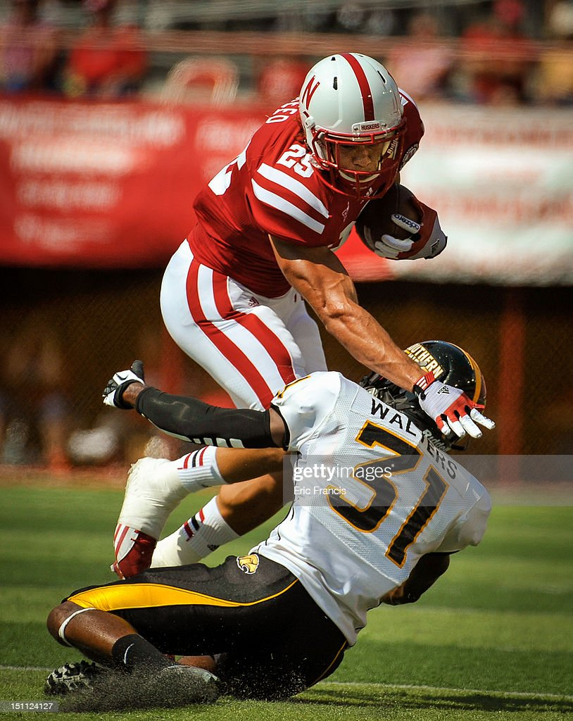 Tight end Kyler Reed #25 of the Nebraska Cornhuskers runs through defensive back Alexander Walters #31 of the Southern Miss Golden Eagles during their game at Memorial Stadium September 1, 2012 in Lincoln, Nebraska. Nebraska won 49-20.