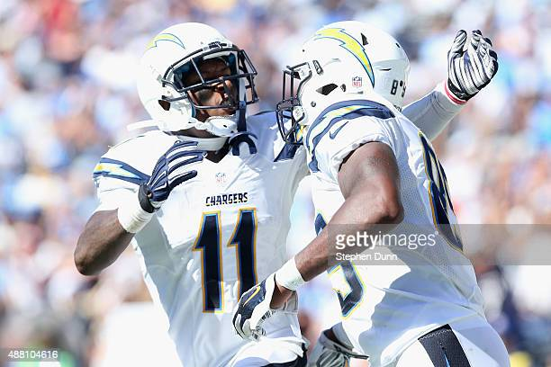 Tight end Ladarius Green is congratulated by wide receiver Steve Johnson of the San Diego Chargers after a touchdown reception against the Detroit...