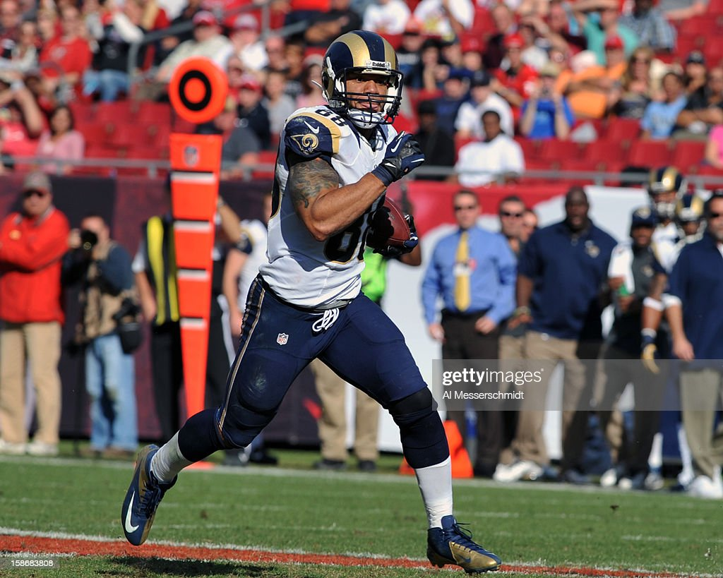 Tight end Lance Kendricks #88 of the St. Louis Rams runs 80 yards with a pass for a touchdown against the Tampa Bay Buccaneers December 23, 2012 at Raymond James Stadium in Tampa, Florida. The Rams won 28 - 13.