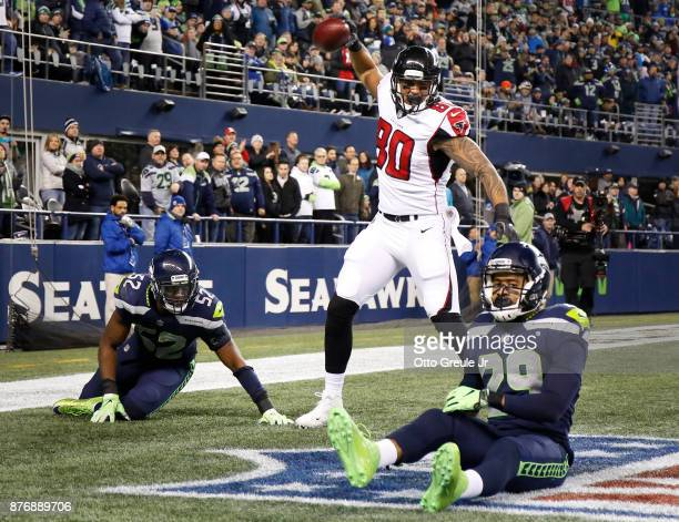 Tight end Levine Toilolo of the Atlanta Falcons spikes the ball to celebrate his 25 yard touchdown as linebacker Terence Garvin of the Seattle...