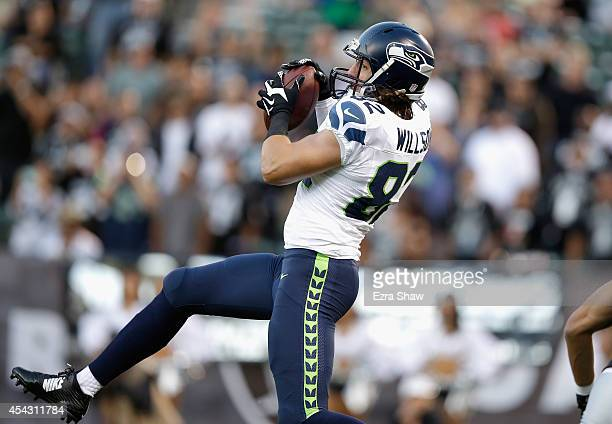 Tight end Luke Willson of the Seattle Seahawks catches a pass for a touchdown against the Oakland Raiders during a preseason game at Oco Coliseum on...