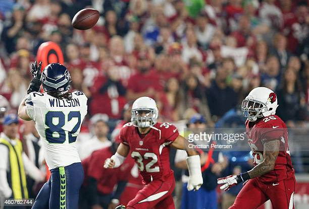 Tight end Luke Willson of the Seattle Seahawks catches the football under pressure from free safety Rashad Johnson and free safety Tyrann Mathieu of...