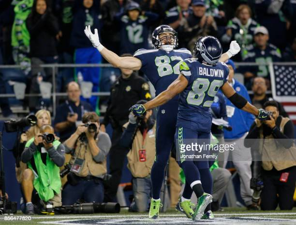 Tight end Luke Willson of the Seattle Seahawks celebrates his touchdown with wide receiver Doug Baldwin in the fourth quarter of the game at...