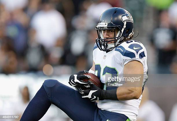 Tight end Luke Willson of the Seattle Seahawks controls a touchdown pass against the Oakland Raiders during a preseason game at Oco Coliseum on...