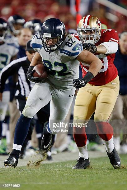 Tight end Luke Willson of the Seattle Seahawks picks up 15 yards on a catch against linebacker Aaron Lynch of the San Francisco 49ers in the fourth...