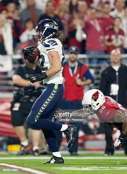 Tight end Luke Willson of the Seattle Seahawks runs the football past free safety Rashad Johnson of the Arizona Cardinals to score a 80 yard...